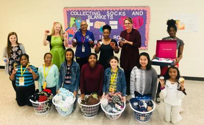 General Ray Davis students donate socks and blankets to Rockdale Senior Center