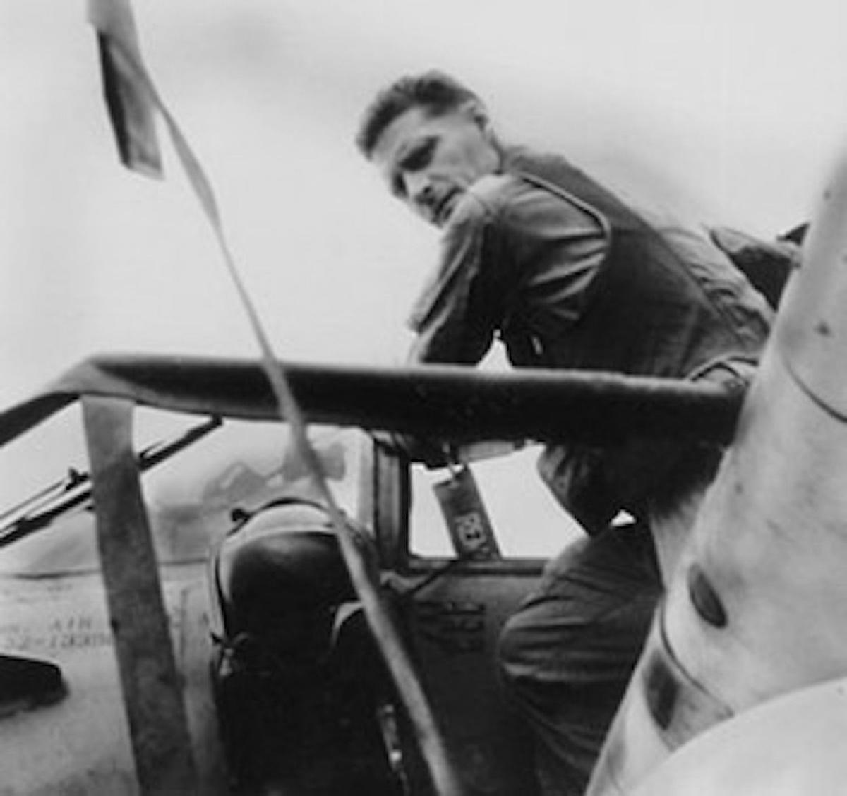 Major Roy Abner Knight, Jr., preparing for another mission in his A-1E Skyraider..jpg