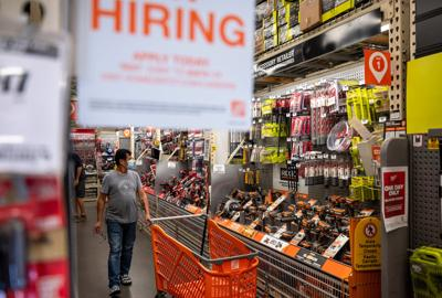Home Depot is boosting hourly wages as housing market booms