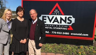 Evans Tool and Die donates pocket crosses to ministry