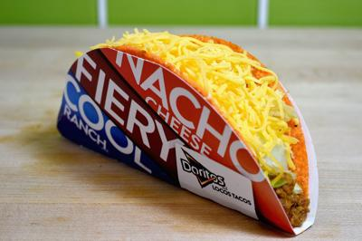 Taco Bell will hand you a free taco on Tuesday -- following proper social distancing protocol