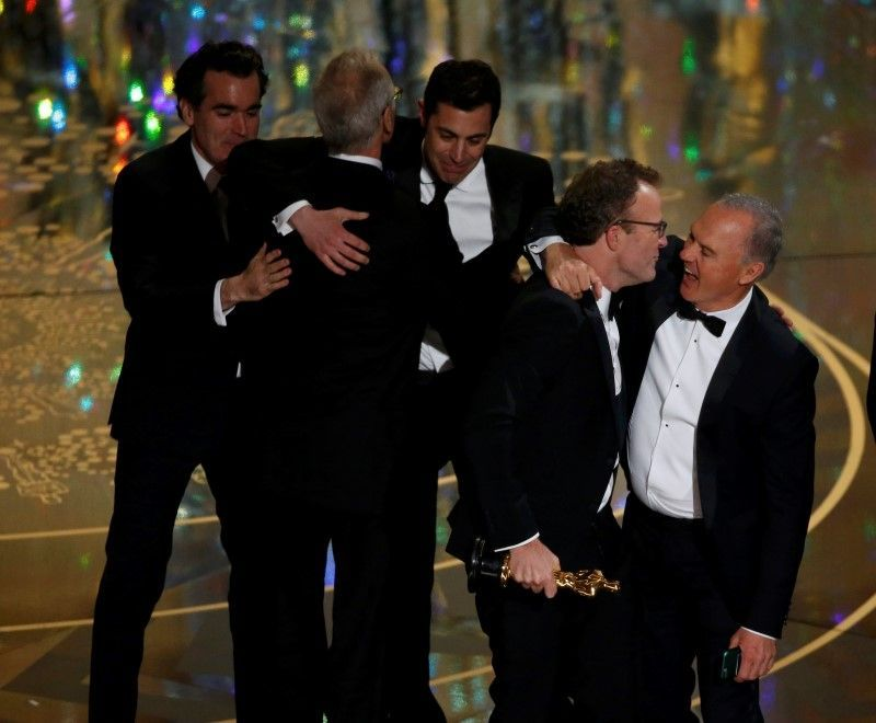 """Actor Keaton hugs director McCarthy after their film """"Spotlight"""" won the Oscar for Best Picture at the 88th Academy Awards in Hollywood,"""