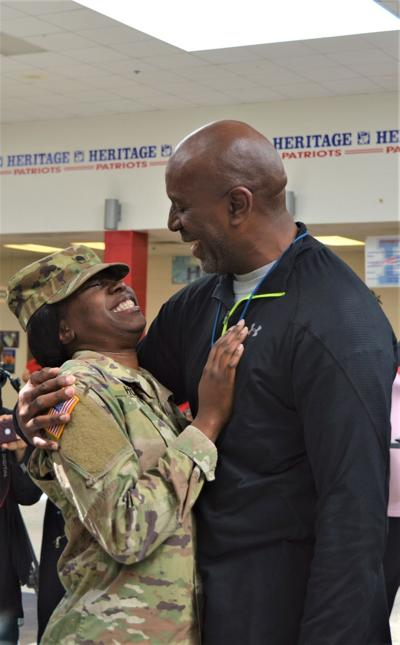 Surprise military homecoming at Heritage High