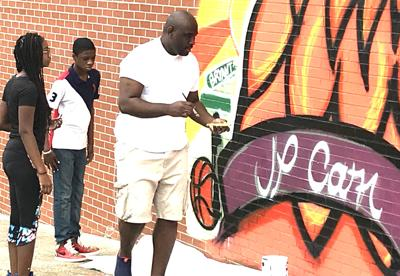 Mural unveiled at J. P. Carr Gymnasium
