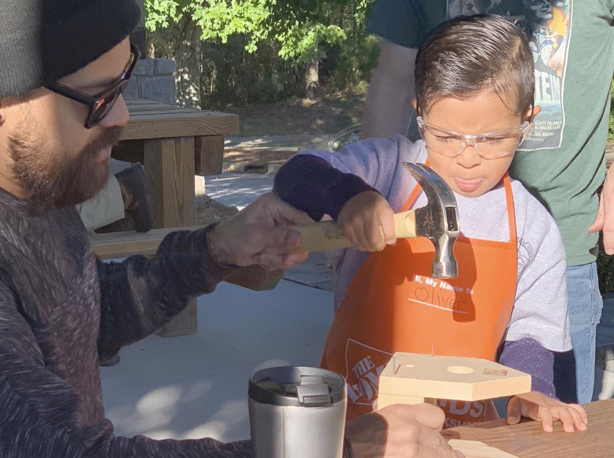 Students and dads build birdhouses together