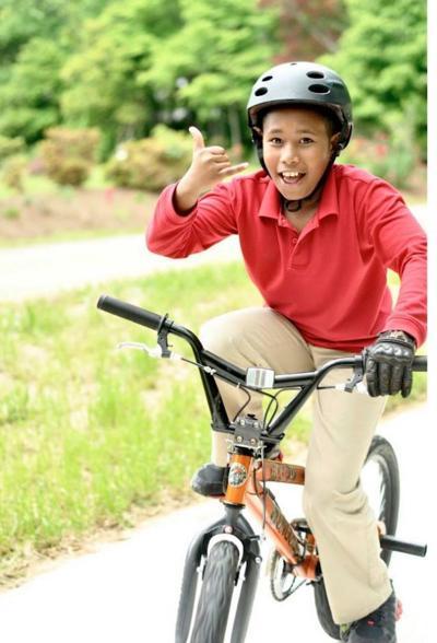 EST kid on bike.jpg