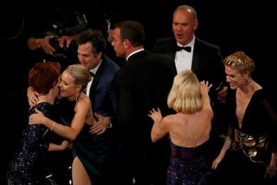 """The cast of the film """"Spotlight"""" react after they won the Oscar for Best Picture at the 88th Academy Awards in Hollywood"""