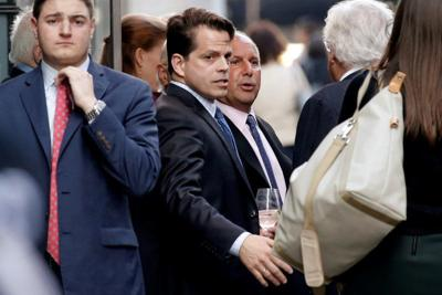 SkyBridge Capital CEO Anthony Scaramucci stands outside Le Cirque restaurant with others before a fundraising event for Republican presidential candidate Donald Trump in New York