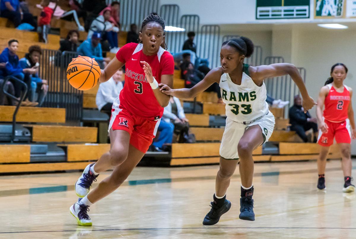 Rockdale's Shaquice May drives to the basket against Grayson