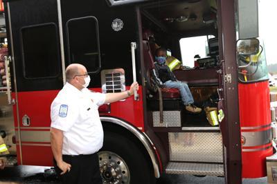 Boy in fire truck.JPG
