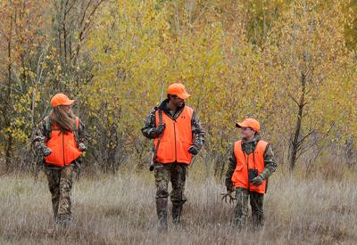"Vermont Fish & Wildlife urges wearing a fluorescent ""hunter orange"" hat and vest while hunting."