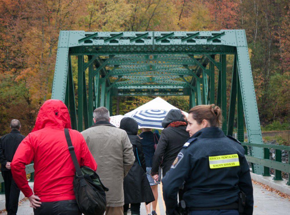 A crowd heads toward the East Richford - Sutton International Bridge for a ribbon cutting ceremony