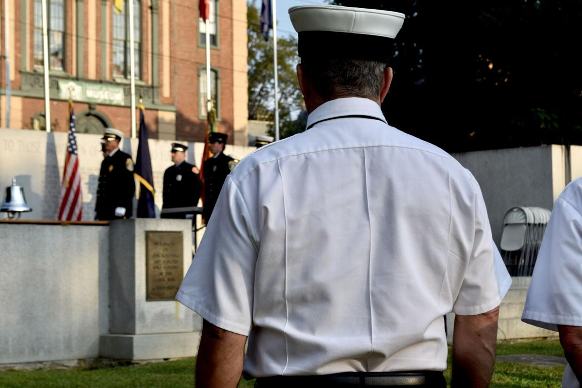 A firefighter stands at attention .JPG
