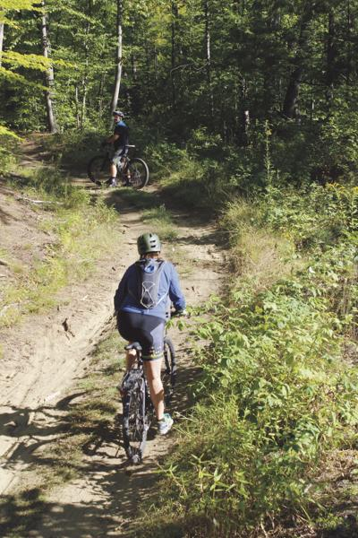 Mountain bikers ride along the trails at Saxon Hill Forest in 2016. Essex's community development department now hopes to create a management plan for the area.