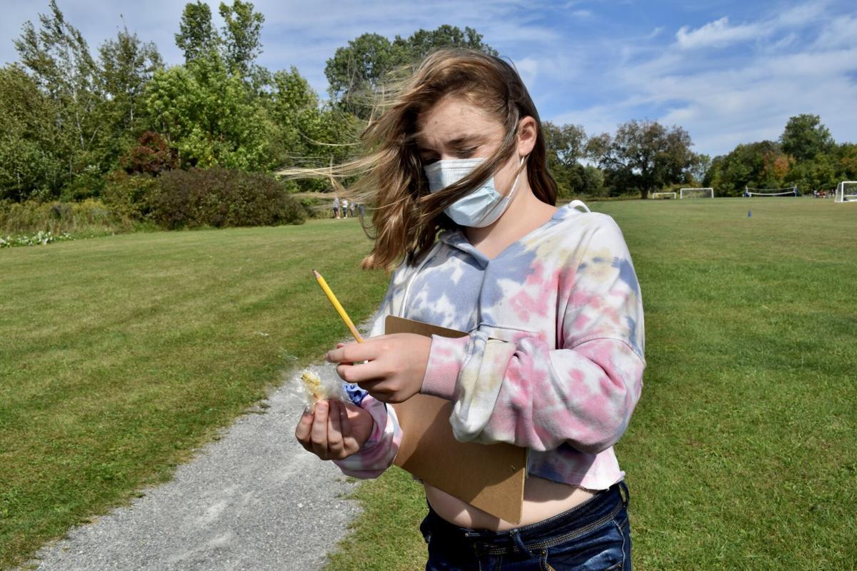 Annabelle Johnson and her milkweed.JPG