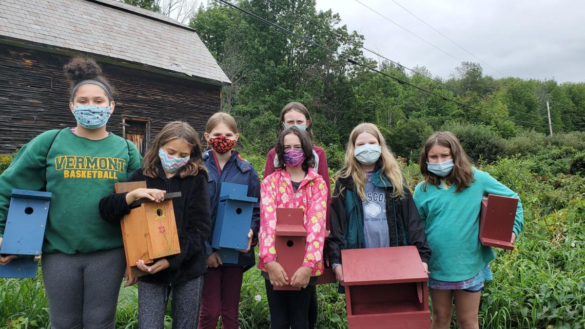 Girl Scouts with birdhouses