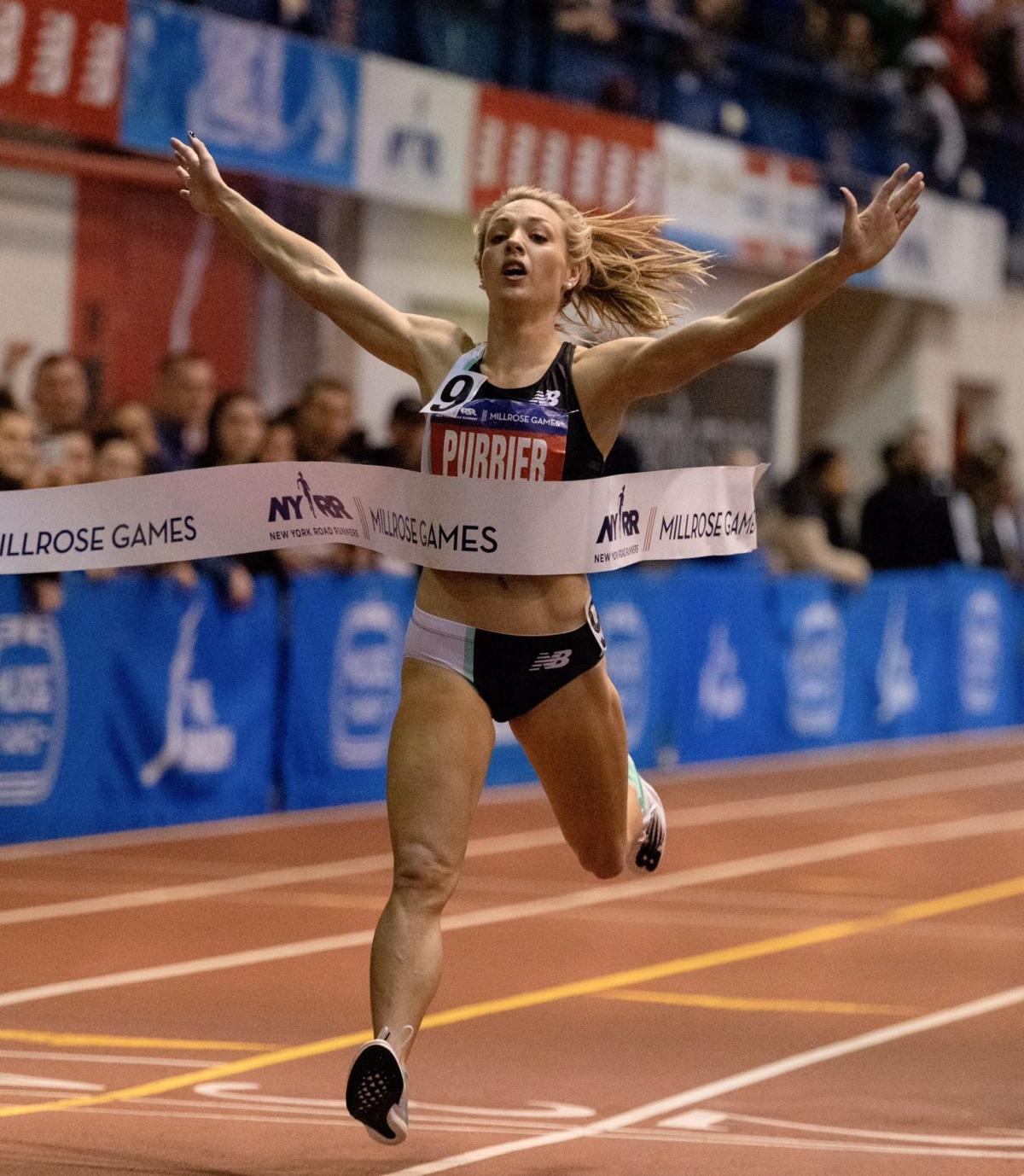 Elle Purrrier crosses the finish line