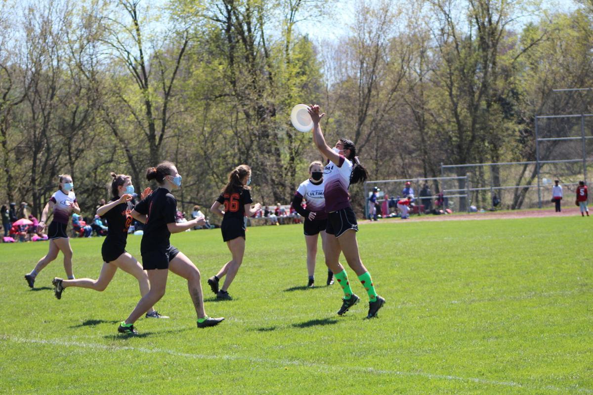 Ultimate frisbee catch girls.jpg