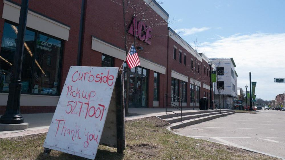 Ace gives out flags for supporting local business