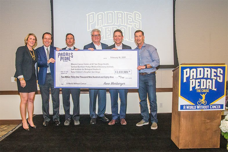Padres Pedal the Cause Presents Check to Local Researchers