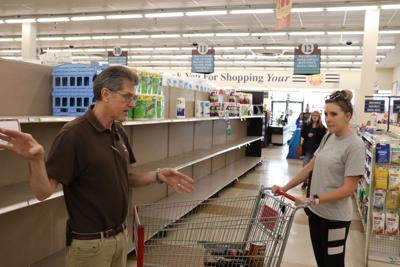 Virus creates empty grocery store shelves