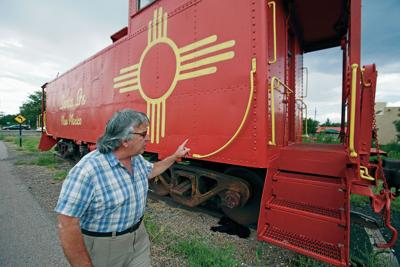Red caboose staying in Santa Fe