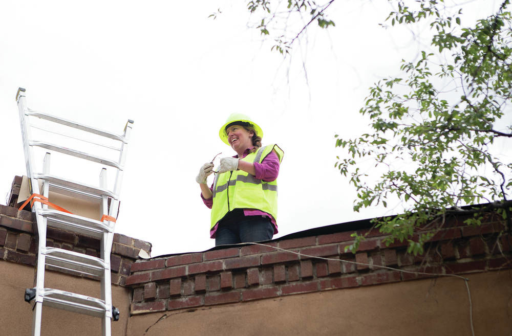81ba6b2c Hillary McPartlon and her mostly female team showing that women belong in  roofing