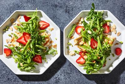 Pile strawberries and snap peas atop grilled chicken for a fresh approach to a spring salad