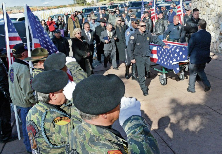 Dozens gather to honor Marine who died alone