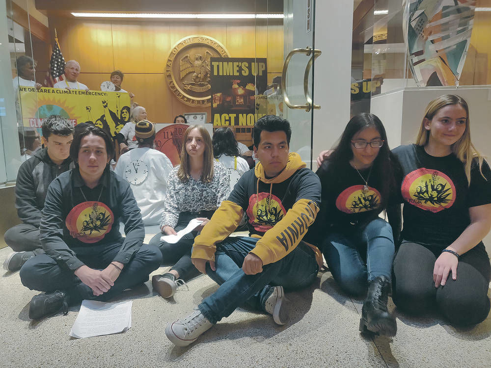 Climate protesters cited at New Mexico Capitol after sit-in