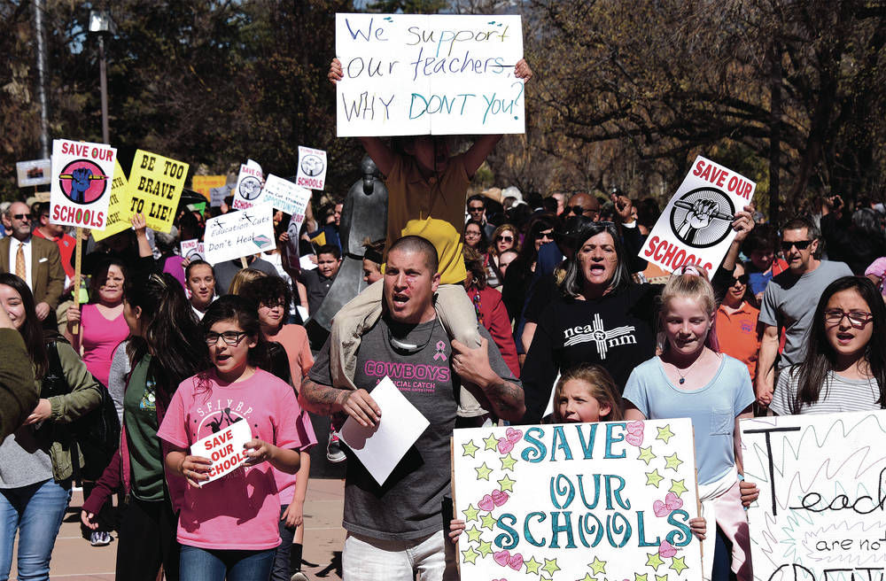 More than 1,500 join 11th-hour protest of education cuts