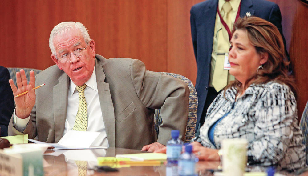Last-minute shuffles cement state budget deal