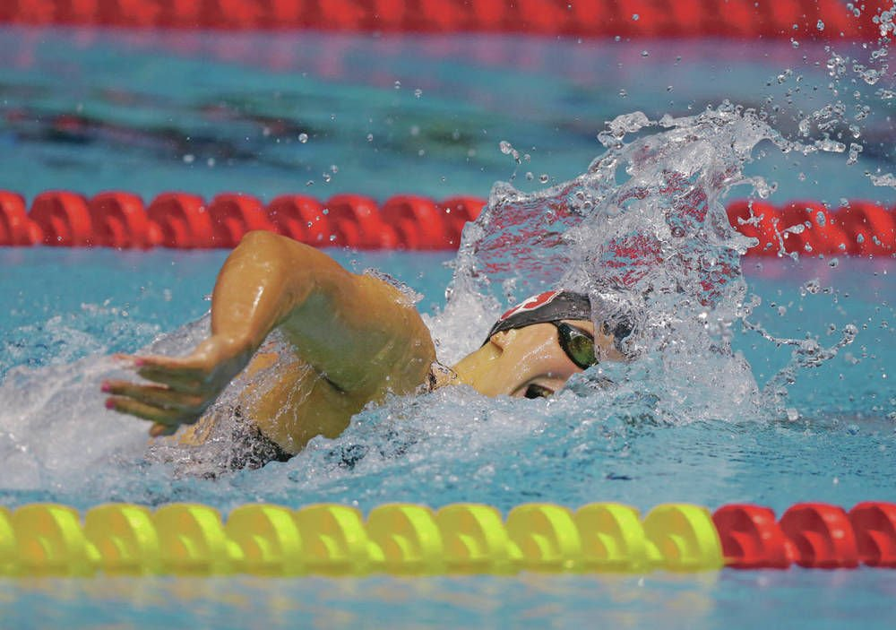 Ledecky wins historic 12th gold