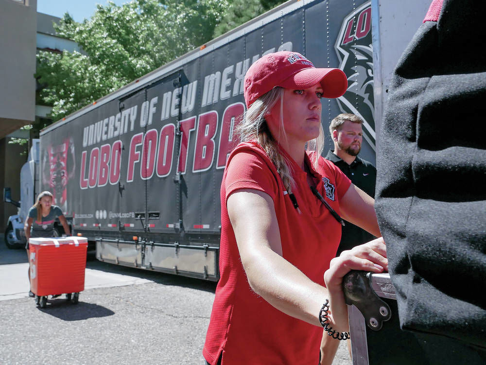 Small army of movers gets Lobos' gear on road