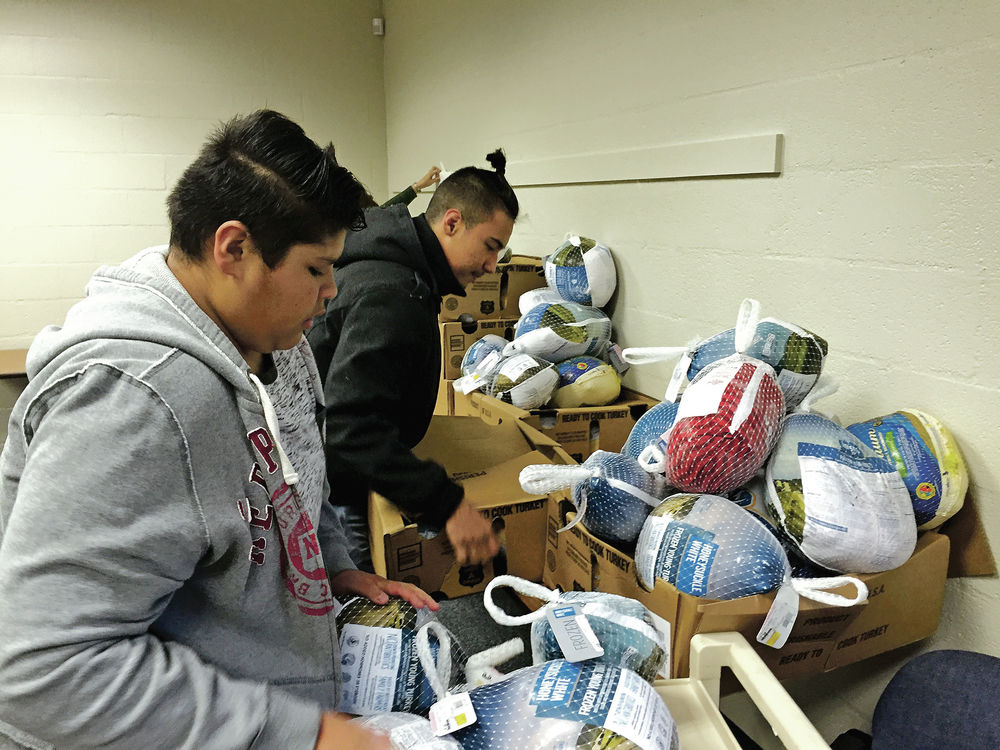 Capital students raise funds, box up holiday meals for homeless