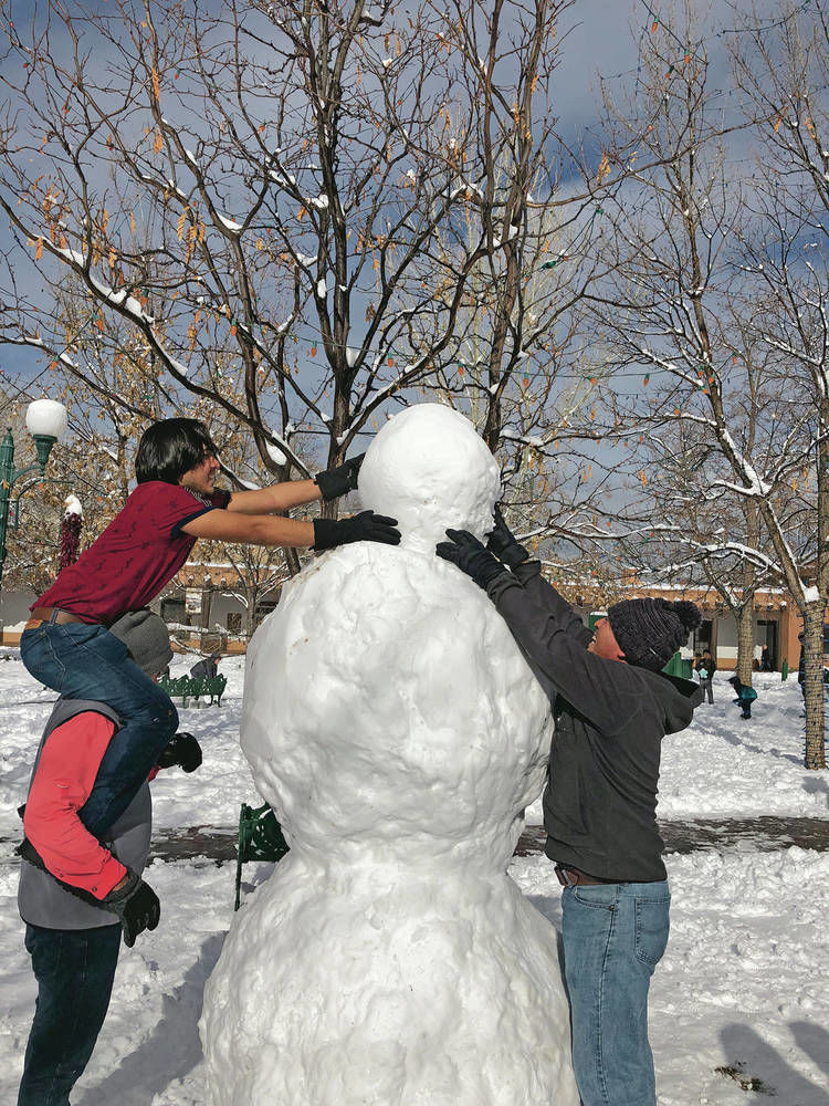 Wintry blast brings out snow artists on Santa Fe Plaza