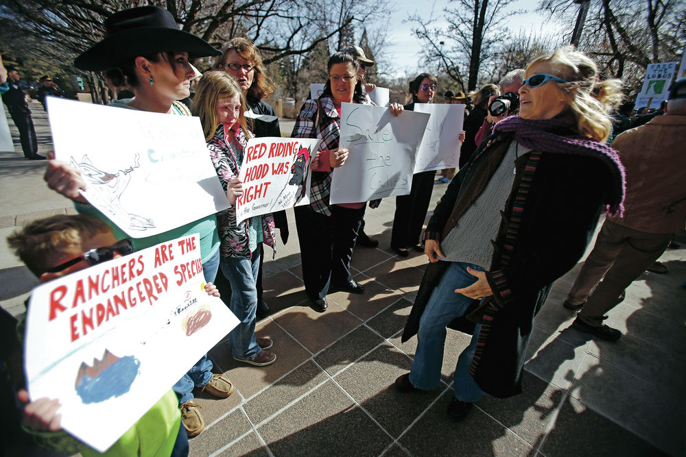 Wolf lovers, ranchers face off in competing Capitol rallies