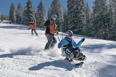 People with disabilities able to enjoy outdoors year round with Adaptive Sports Program instructors