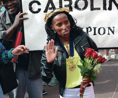 Thief nabs Boston Marathon winner's purse