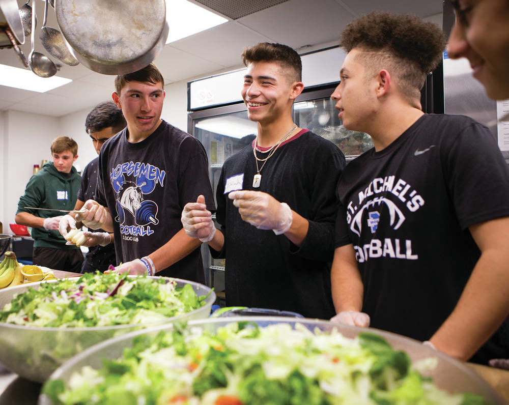 At shelter, St. Michael's football players get a lesson in service
