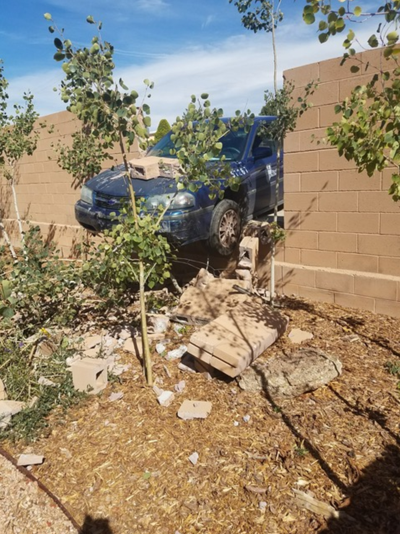 Car crashes into wall after Santa Fe parking enforcement officer fails to put car in park