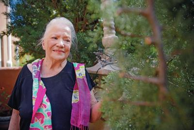 Resident of public housing keeps her trees, but worries about eviction