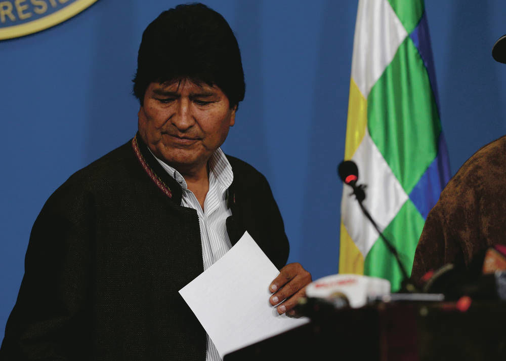 Bolivia's president resigns after pressure from military, protesters