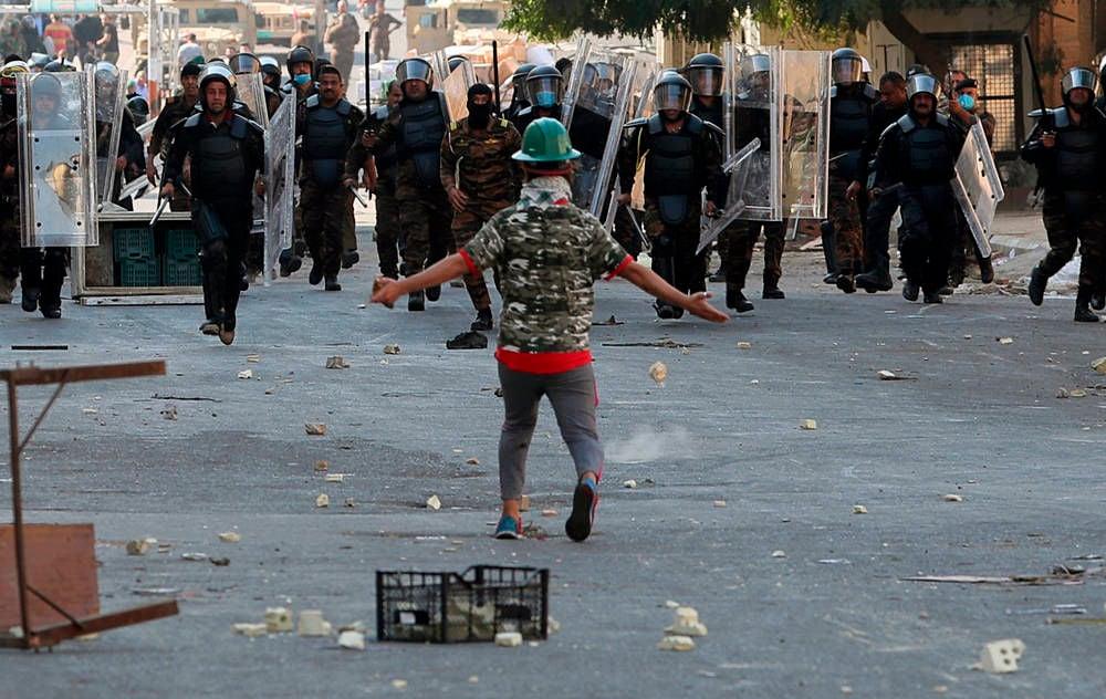 Iraq protesters storm Baghdad bridge; medic killed