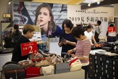 Trump raises tariffs as China trade war escalates