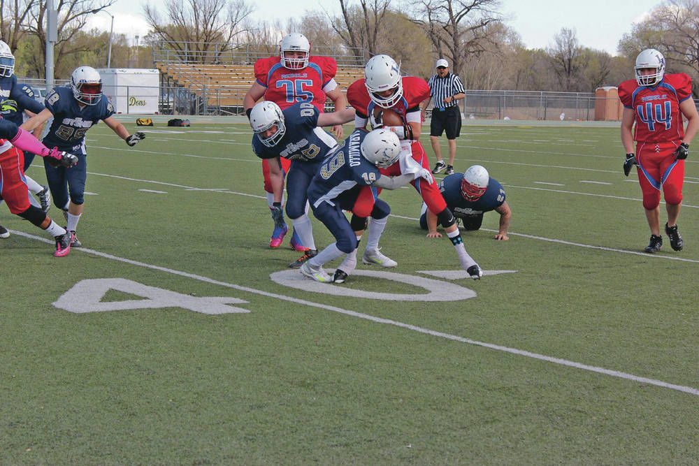 Semi-pro football team Santa Fe Sting endures two decades for joy of playing game