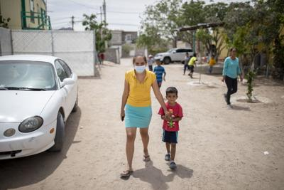 Expelled from U.S. in name of public health, migrants in limbo in Mexico