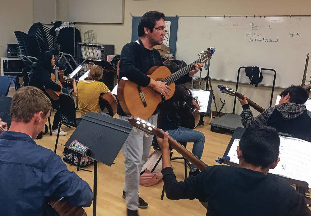 Strumming to beat of different music program in Santa Fe