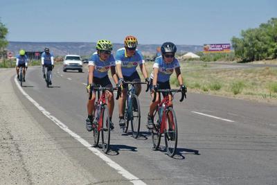 Ukrainian bicyclists ride through Santa Fe to raise awareness of adoptions