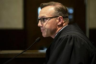 Oklahoma judge reduces opioid award by $107M